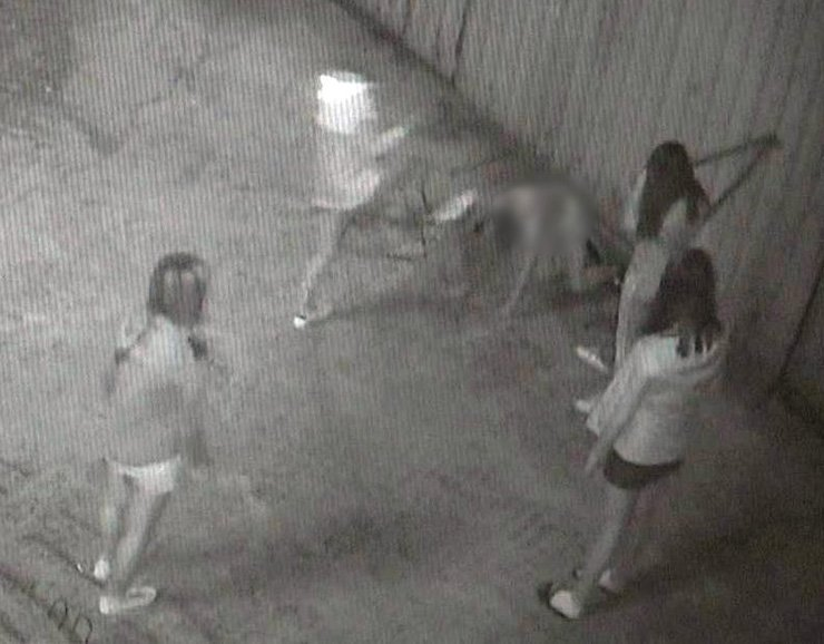 In surveillance camera footage, a schoolgirl victim is on her hands and knees as she is kicked in the head by one of four attackers./Yonhap