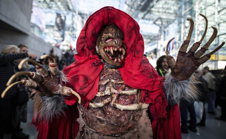 An attendee dressed as the monster from 'The Village' poses during New York Comic Con at the Jacob K. Javits Convention Center on Saturday, Oct. 5, 2019, in New York. AP