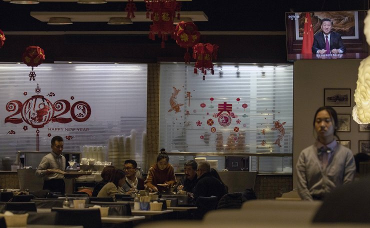 Chinese President Xi Jinping is seen on a televised New Year address on a television screen in a restaurant in Beijing on Tuesday, Dec. 31, 2019. In the New Year's address Tuesday evening, Xi called for Hong Kong to return to stability following months of pro-democracy protests. AP
