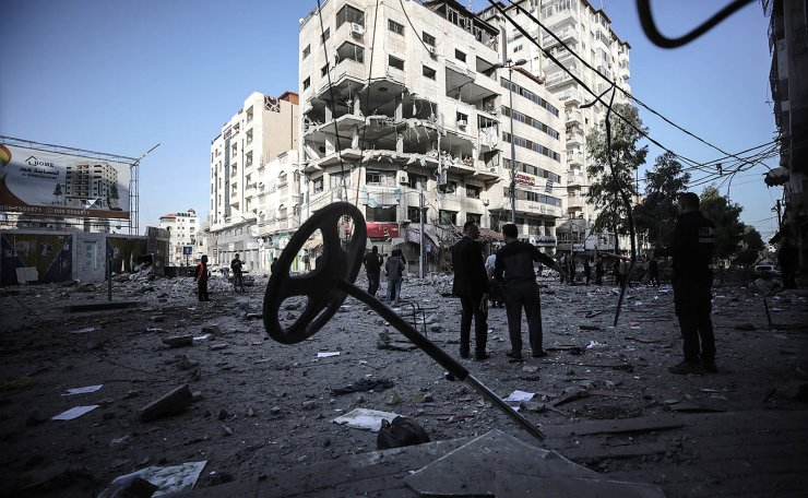 Palestinians inspect rubble of a destroyed building damaged after an Israeli air strike in Gaza City, 05 May 2019. Media reports state that more than 250 rockets have been fired into Israel by millitants and Israel have replied with air strikes and tank fire on the Palestinian territory.  EPA
