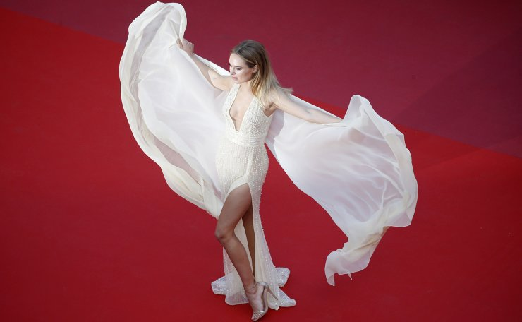 72nd Cannes Film Festival - Screening of the 'The Traitor'(Il traditore) in competition - Red Carpet Arrivals - Cannes, France, May 23, 2019. Kimberly Garner poses. Reuters