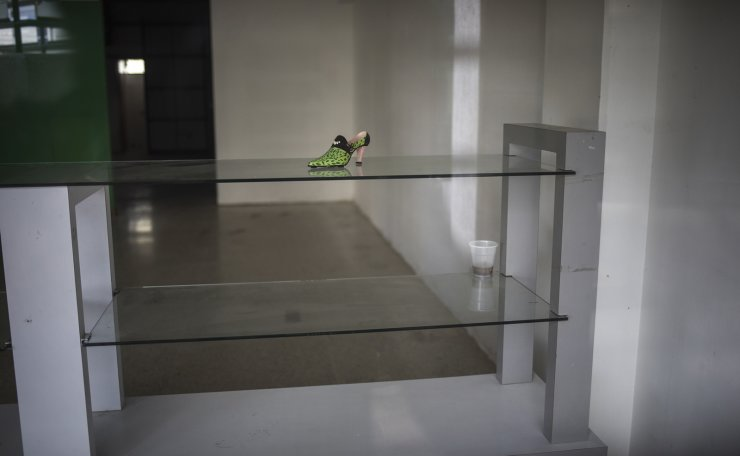 A lone shoe sits on a display table at a store that was unable to reopen after the mall where it is located was looted during nation-wide blackouts in Maracaibo, Venezuela, Nov. 21, 2019. For many in Maracaibo, Venezuela's economic crash in the last five years hit especially hard. AP