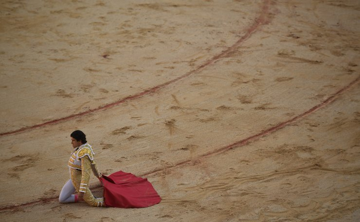 Spanish bullfighter Alberto Lopez Simon, performs in the bullring during a bullfight at the San Fermin Festival in Pamplona, northern Spain, Sunday, July 7, 2019. Revelers from around the world flock to Pamplona every year to take part in the eight days of the running of the bulls. AP