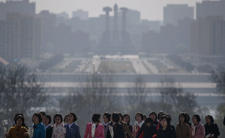 People arrive to pay their respects before the statues of late North Korean leaders Kim Il Sung and Kim Jong Il, as part of celebrations marking the anniversary of the birth of Kim Il Sung, known as the 'Day of the Sun', on Mansu hill in Pyongyang on April 15, 2019. AFP