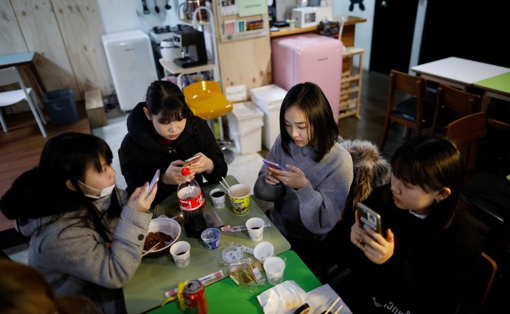 Japanese Yuuka Hasumi, 17, who wants to become a K-pop star, and her friends have lunch after a Korean language class in Seoul, South Korea, March 12, 2019. Reuters