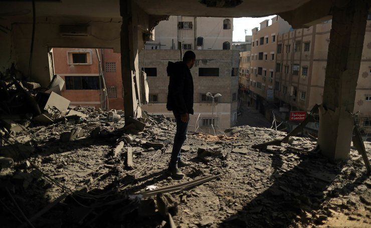 A Palestinian man inspects a building destroyed in Israeli air strikes, in Gaza City May 5, 2019. Reuters