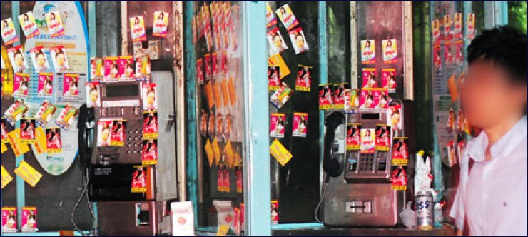 Public telephone booths filled with leaflets selling sex near Gangnam Subway Station in southern Seoul. To evade crackdowns, prostitutes have retreated into residential areas, renting offices and apartments. / Korea Times file
