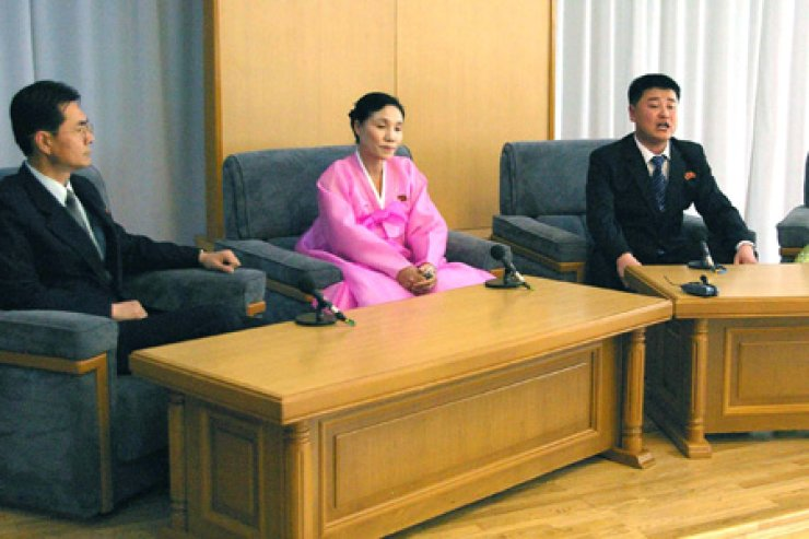The North's Korean Central News Agency broadcasts a discussion with defectors who returned to the North, Friday. They mostly said they were tempted to go to South Korea, but the reality was too harsh. Yonhap