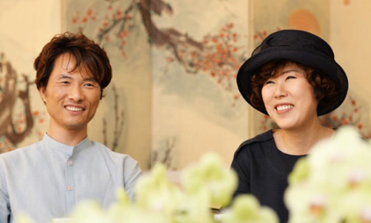 Oh Chung, left, CEO of KOOD Inc. and his wife Park Kyoung-won, creative director at Si.Wha.Dam smile while talking about 'hansik' or Korean food at the restaurant in Itaewon, Thursday./ Korea Times photo by Shim Hyun-chul
