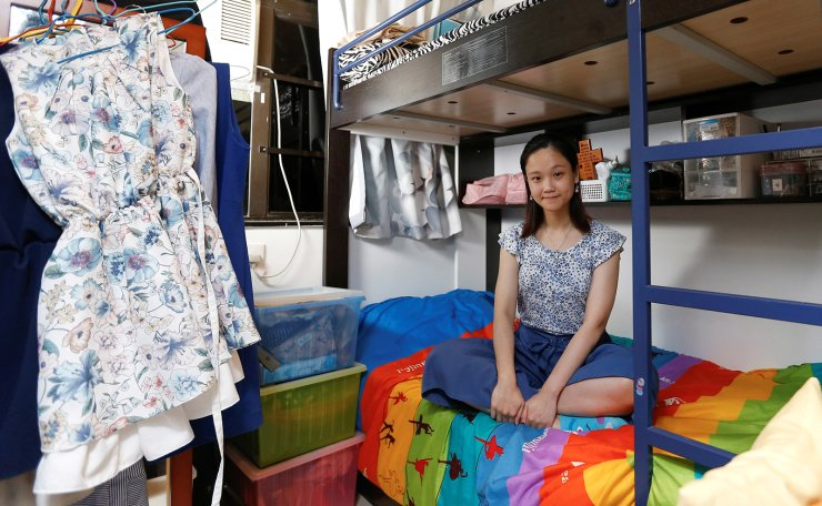Native Hong Kong resident Eunice Wai, 30, a primary school teacher, who lives with her parents and a brother, poses for a picture in her 7.4 sq metre bedroom of her family's apartment in Hong Kong, China, June 25, 2019. Wai explained how Hong Kong people felt stifled by Beijing: 'They control people more and give us less freedom.' But she said other problems made life increasingly difficult, in particular what she said was an unfair housing policy that only seemed to make the rich richer. 'Housing is one of the most important ones. We have so little room in Hong Kong and people find it hard to buy a flat. The property companies control the market.' Reuters