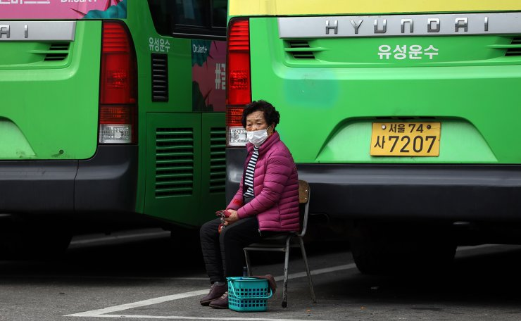 A woman wearing a face mask is seen at a bus terminal t in Seoul, South Korea, Wednesday, Feb. 26, 2020. Korea Times photo by Choi Won-suk