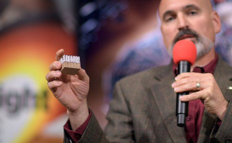 Tim Priser, Quality Director, Lockheed Martin Space talks shows a small piece of the Mars InSight heat shield during a social media briefing, on November 25, 2018 at NASA's Jet Propulsion Laboratory in Pasadena, California. AFP