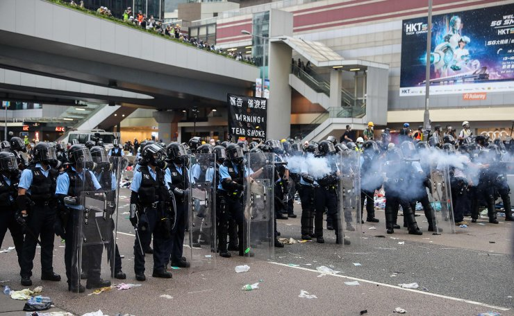 Police fire tear gas at protesters during a rally against a controversial extradition law proposal outside the government headquarters in Hong Kong on June 12, 2019. AFP