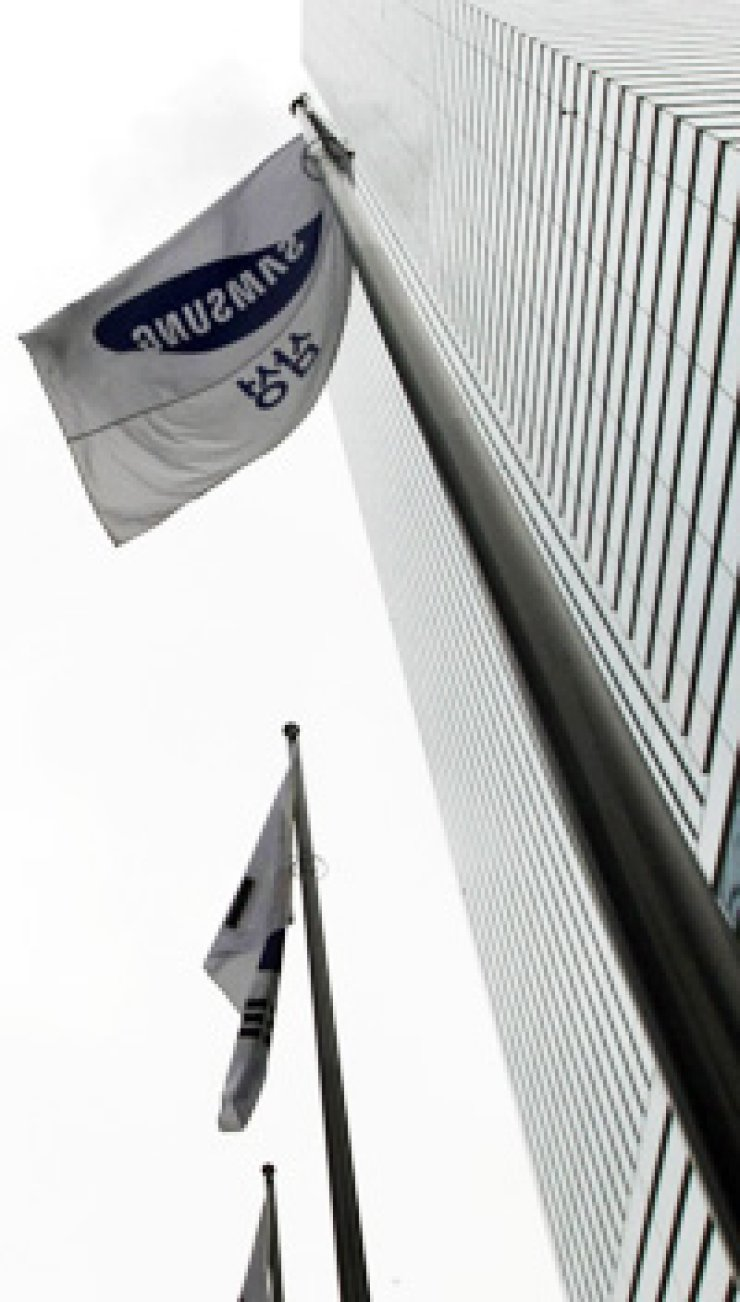 Samsung Group recently merged its affiliates in a move to concentrate on key businesses and develop new cash generators./ Korea Times file