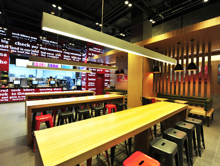 People enjoy a meal at shabu-shabu restaurant Cheiljemyunso located at International Finance Center Mall in Yeouido. The restaurant, run by CJ Foodville, set up a bar equipped with individual burners to better accommodate solo diners. / Courtesy of CJ Foodville