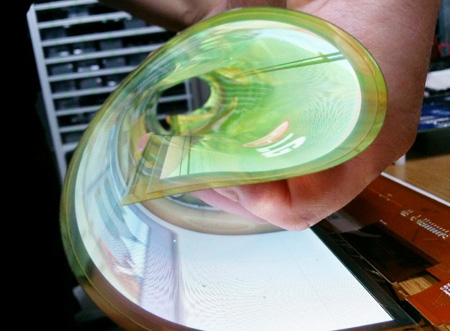 An LG Display employee demonstrates a 18-inch transparent OLED display, which is featured with 30 percent transmittance - a significant improvement over previous models with only reach around 10 percent, Thursday. / Courtesy of LG Display