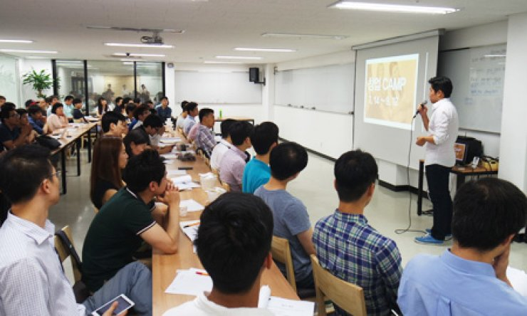 Participants in the 'Fast Campus' program offered by Fast Track Asia attend a lecture about how to develop programs for improved startups as a part of its curriculum in this file photo, Thursday. / Courtesy of Fast Track Asia