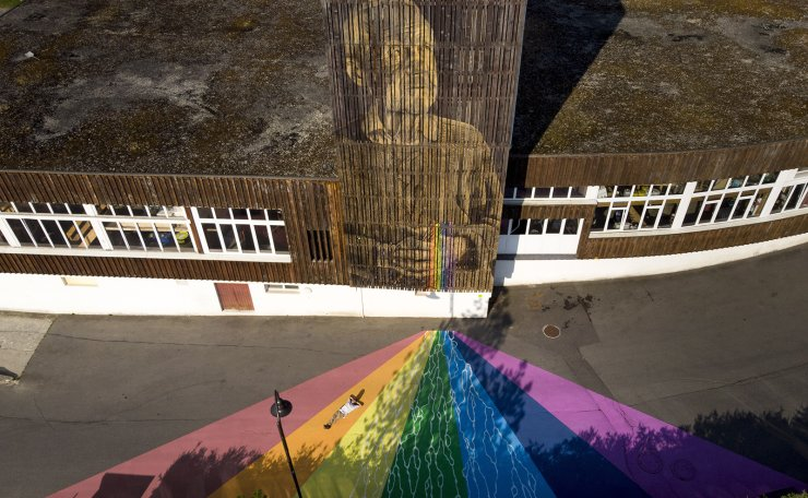 An image taken with a drone showing the giant fresco  Fluidity of Swiss street artist Antoine Guignard (lying on the ground) aka LPVDA (les pinceaux verts d'Antoine) during the AILYOS art nature festival, in Leysin, Switzerland, 25 July 2019. EPA