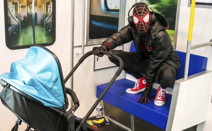 An attendee dressed as Spider-Man watches over a baby during New York Comic Con at the Jacob K. Javits Convention Center on Friday, Oct. 4, 2019, in New York. AP