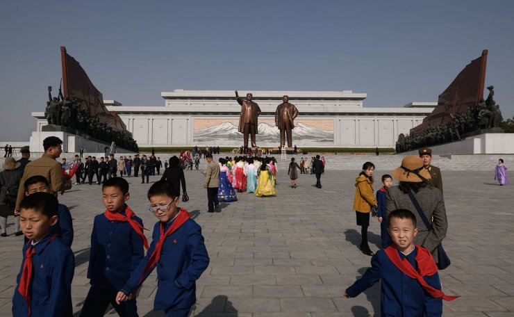 A group of students leave after paying their respects before the statues of late North Korean leaders Kim Il Sung and Kim Jong Il, as part of celebrations marking the anniversary of the birth of Kim Il Sung, known as the 'Day of the Sun', on Mansu hill in Pyongyang on April 15, 2019. AFP