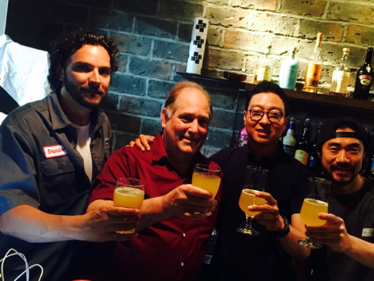 Phil Kelm, second from left, and Bryan Do, third from left, toast Korea's first cider - with a glass ofthe same. /  Courtersy of Andrew Salmon