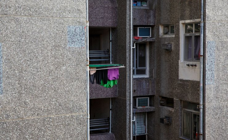 Laundry hangs out to dry in a residential apartment complex in Hong Kong, China, June 27, 2019. Reuters