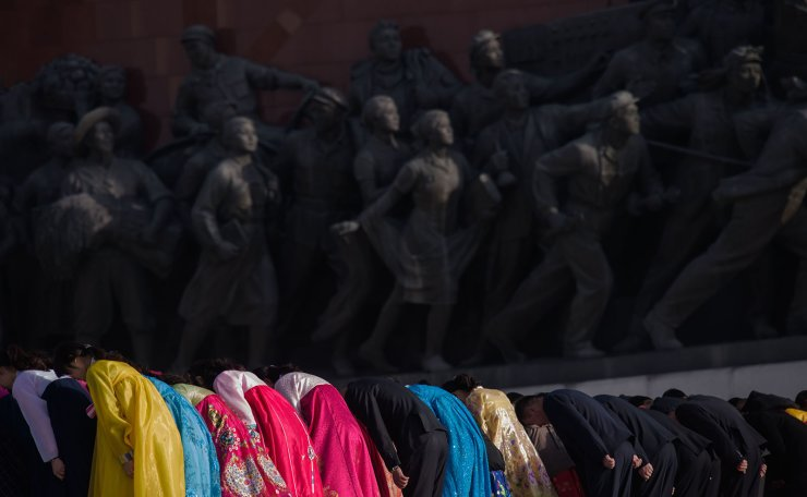 People bow as they pay their respects before the statues of late North Korean leaders Kim Il Sung and Kim Jong Il, as part of celebrations marking the anniversary of the birth of Kim Il Sung, known as the 'Day of the Sun', on Mansu hill in Pyongyang on April 15, 2019. AFP