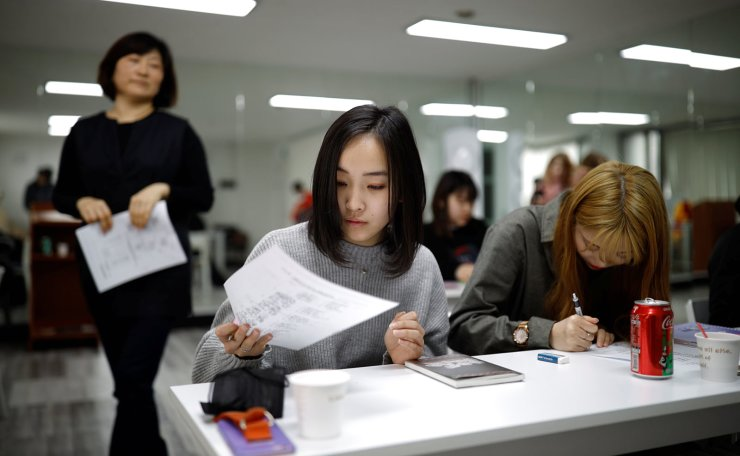 Japanese Yuuka Hasumi, 17, and Yuho Wakamatsu, 15, also from Japan, who want to become K-pop stars, attend a Korean language class in Seoul, South Korea, March 12, 2019. Reuters