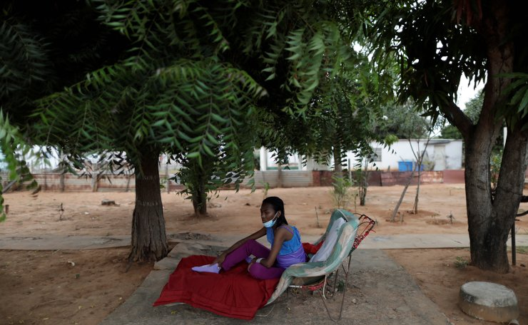 Aidalis Guanipa, 25, a kidney disease patient, rests under a tree after a day of dialysis, at her home in La Concepcion, Venezuela April 26, 2019. Reuters