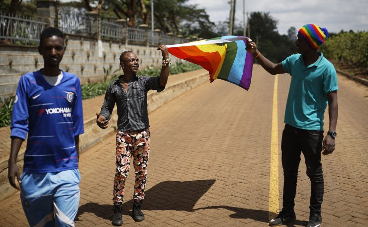 In this photo taken Friday, May 17, 2019, Ali Djabiri, an LGBT refugee from Congo, center-left, joins other LGBT refugees and their supporters living in Kenya at a protest against their treatment by authorities, outside an office of the UN refugee agency UNHCR in Nairobi, Kenya. Kenya's High Court is due to rule Friday, May 24, 2019 on whether laws that criminalize same sex relations are unconstitutional. AP