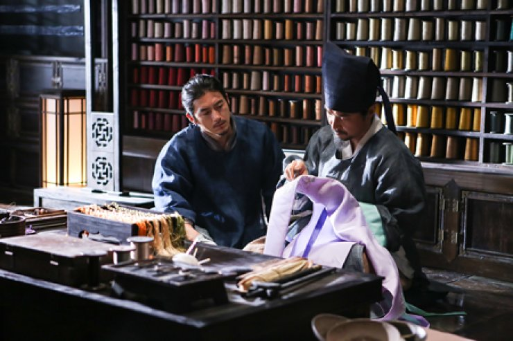 Han Suk-kyu, right, and Go Soo in a scene from the film 'The Royal Tailor' / Courtesy of Waw Pictures