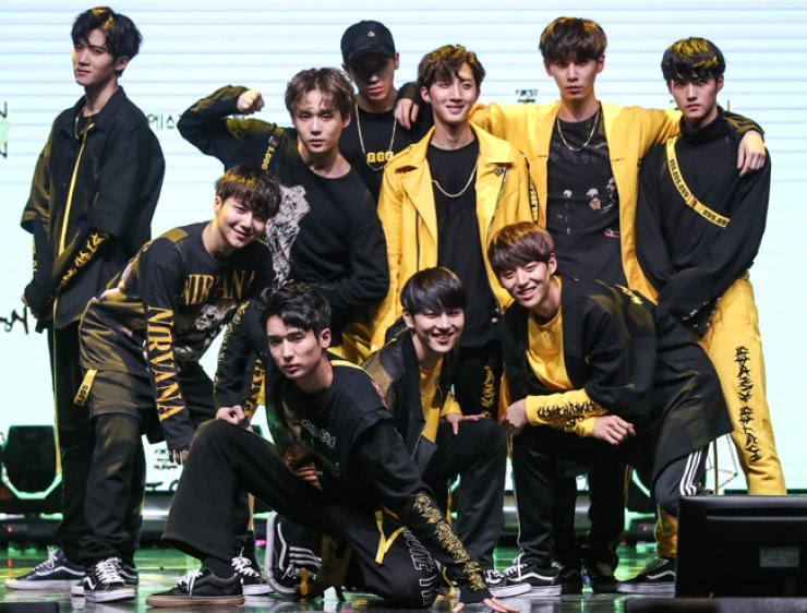 Members of Pentagon, Cube Entertainment's new boy band, pose during their debut showcase at Sebitseom in Seocho, southern Seoul, Monday. / Courtesy of Cube Entertainment