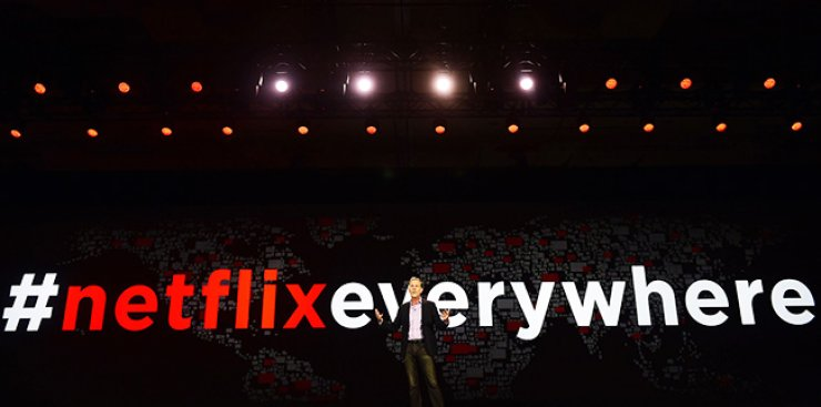 Netflix CEO Reed Hastings gives a keynote address at the CES 2016 Consumer Electronics Show in Las Vegas, Wednesday. / AFP-Yonhap