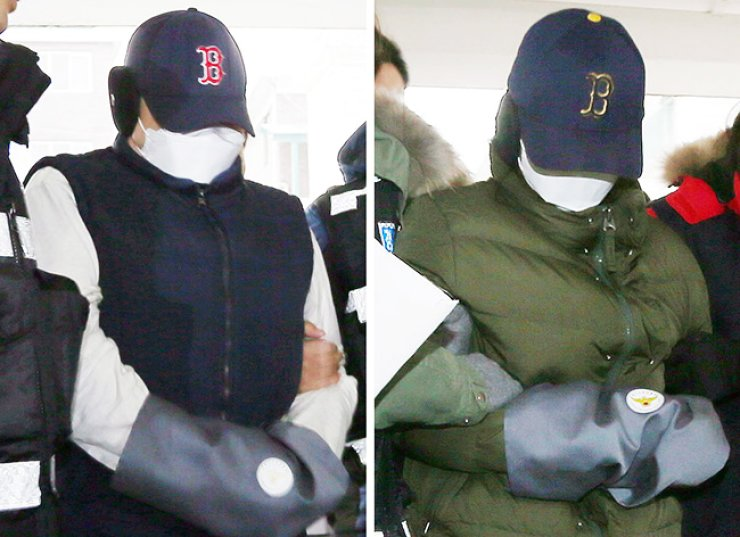 Parents accused of the murder and dismemberment of their 7-year-old boy return to their former residence in Bucheon, Gyeonggi Province, for a reenactment of the crime, Thursday. The father, left, surnamed Choi, 34, and the mother, surnamed Han, 34, allegedly beat their son for about two hours prior to his death in November, 2012, and then dismembered him. / Yonhap