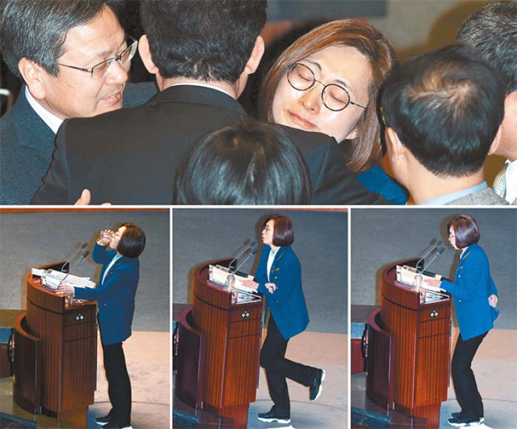 Rep. Eun Soo-mi of the main opposition Minjoo Party of Korea hugs a fellow lawmaker after ending the country's longest filibuster of 10 hours and 18 minutes at the National Assembly, Wednesday. In the below photos, the lawmaker drinks and exercises during the speech. / Korea Times photo by Koh Young-kwon