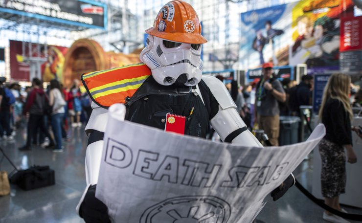 An attendee dressed as a construction worker Stormtrooper poses during New York Comic Con at the Jacob K. Javits Convention Center on Friday, Oct. 4, 2019, in New York. AP