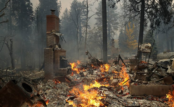 A chimney remains at the site of a home that burned as the Camp Fire moves through the area on November 8, 2018 in Paradise, California. AFP