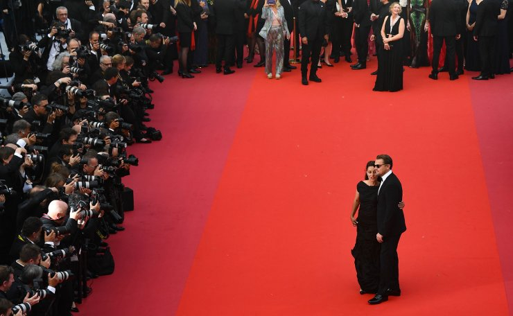 US actor Leonardo DiCaprio (R) and US director Leila Conners arrive for the screening of the film 'Ice on Fire' at the 72nd edition of the Cannes Film Festival in Cannes, southern France, on May 22, 2019. AFP