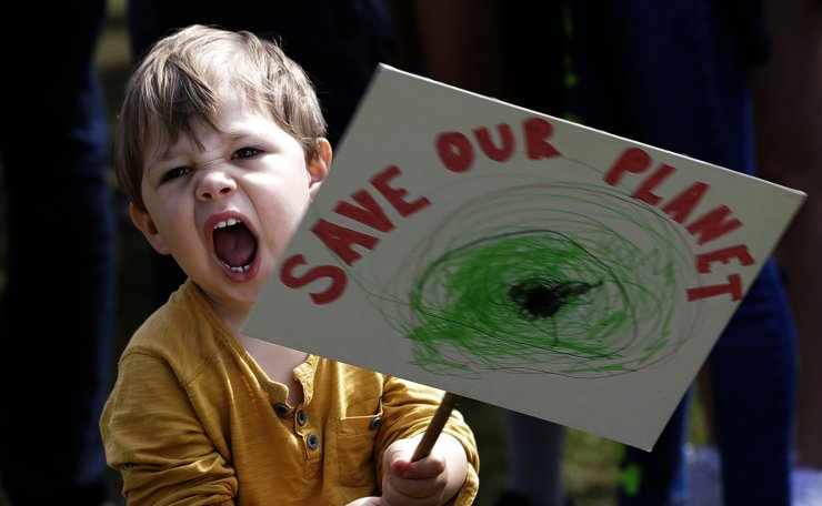 A young protestor takes part in a demonstration organised by 'Global Strike 4 Climate' in Parliament Square in London, Friday, May 24, 2019. AP