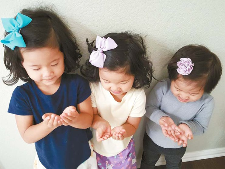 The girls practice saying 'please' as they start learning that manners matter in the real world. / Courtesy of Jane Han