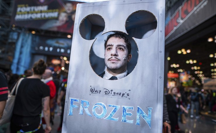 An attendee dressed as Frozen Walt Disney poses during New York Comic Con at the Jacob K. Javits Convention Center on Friday, Oct. 4, 2019, in New York. AP