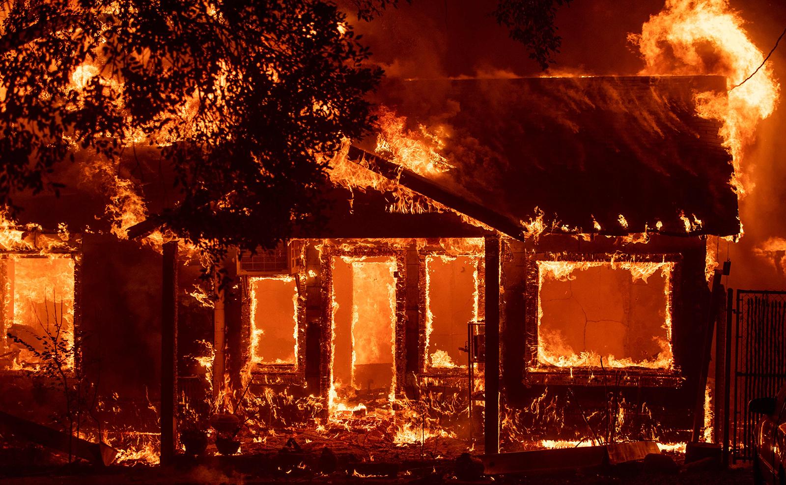A home burns as the Camp fire tears through Paradise, California on November 8, 2018. AFP