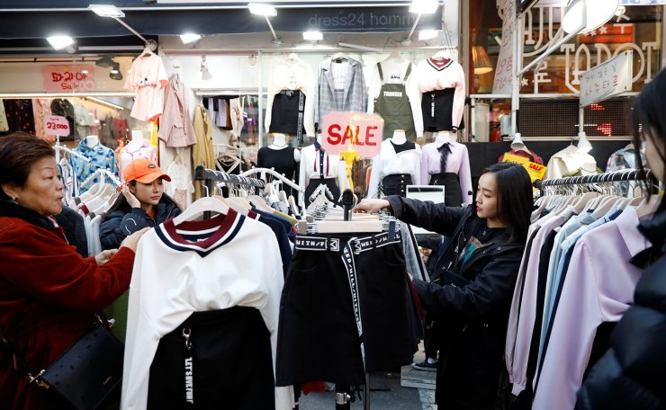 Japanese Yuuka Hasumi, 17,  who wants to become a K-pop star, shops after class in the Hongdae area of Seoul, South Korea, April 3, 2019. Hasumi put high school in Japan on hold and flew to South Korea in February to try her chances at becoming a K-pop star, even if that means long hours of vocal and dance training, no privacy, no boyfriend, and even no phone. 'It is tough,' Hasumi said. 'Going through a strict training and taking my skill to a higher level to a perfect stage, I think that's when it is good to make a debut. Reuters
