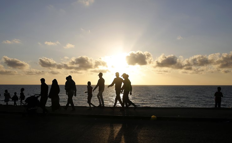 A Palestinian family walks on the beach, in Gaza City, Friday, May 3, 2019. The beach is one of the few open public spaces in this densely populated city. AP