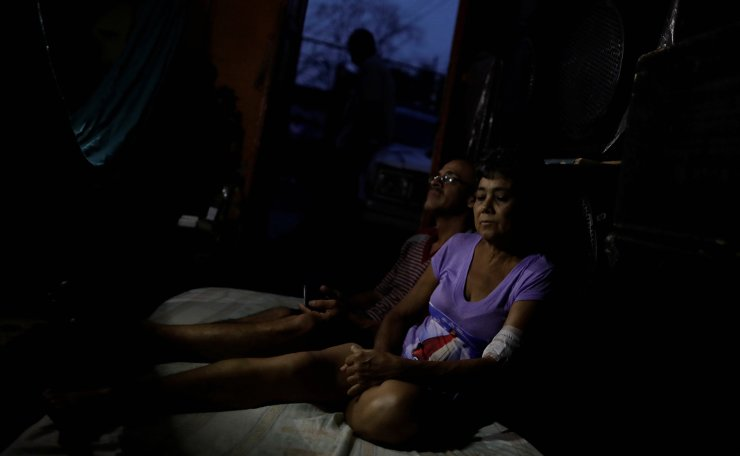 Maria Esis, 52, a kidney disease patient, sits next to her husband Lino Lopez, as they wait for the electricity to return during a blackout, at their house in Maracaibo, Venezuela April 11, 2019. Reuters