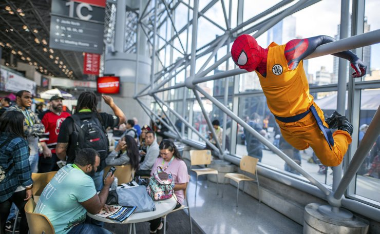 An attendee dressed as Spider-Man hangs on the wall during New York Comic Con at the Jacob K. Javits Convention Center on Friday, Oct. 4, 2019, in New York. AP