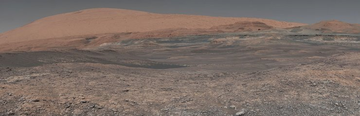 This image provided by NASA, assembled from a series of January 2018 photos made by the Mars Curiosity rover, shows an uphill view of Mount Sharp, which Curiosity had been climbing. In our solar system family, Mars is Earth's next-of-kin, the next-door relative that has captivated humans for millennia. The attraction is sure to grow on Monday, Nov. 26 with the arrival of a NASA lander named InSight. AP