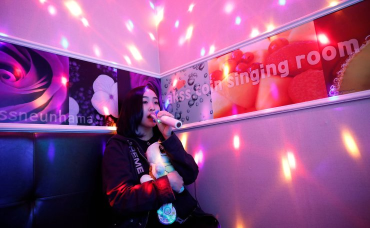 Japanese Yuuka Hasumi, 17, who wants to become a K-pop star, sings a song as she spends time after class, in the Hongdae area of Seoul, South Korea, April 3, 2019. Hasumi put high school in Japan on hold and flew to South Korea in February to try her chances at becoming a K-pop star, even if that means long hours of vocal and dance training, no privacy, no boyfriend, and even no phone. 'It is tough,' Hasumi said. 'Going through a strict training and taking my skill to a higher level to a perfect stage, I think that's when it is good to make a debut. Reuters