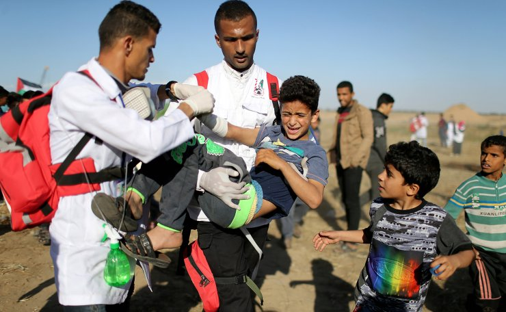 A wounded Palestinian boy is evacuated during a protest at the Israel-Gaza border fence, in the southern Gaza Strip May 3, 2019. Reuters