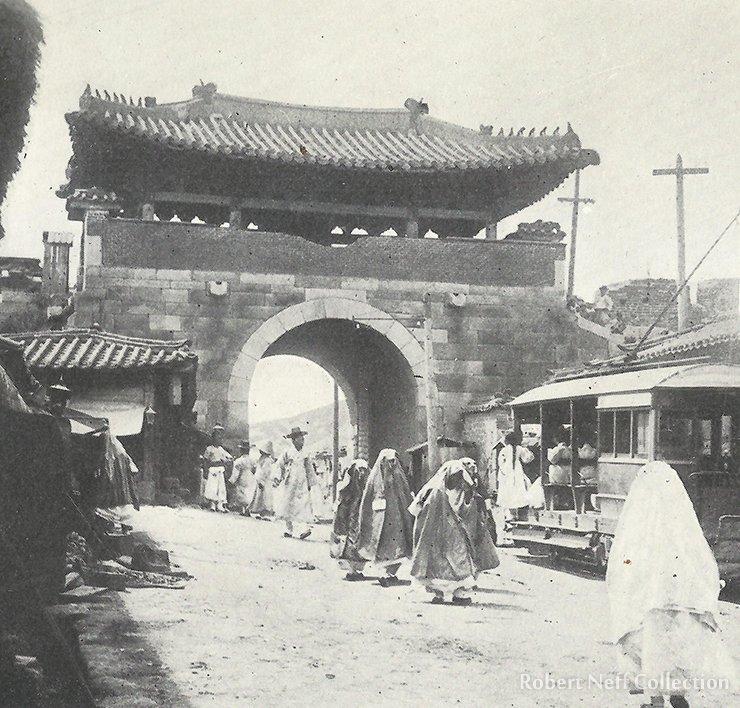 A streetcar passing through the West Gate, circa 1900.